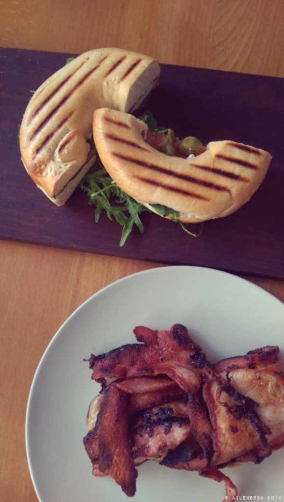 Smoked salmon bagel with a side of crispy bacon