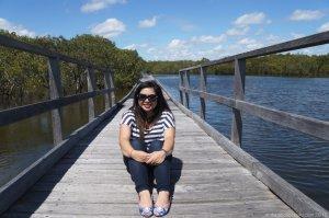 Sitting on the boardwalk at the Urunga Footbridge